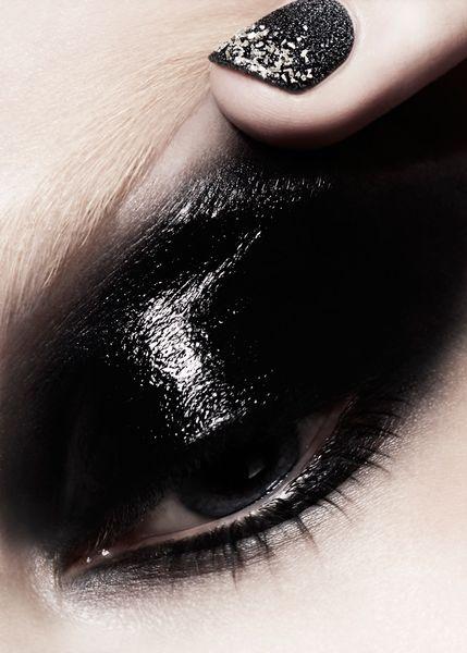 "INSPIRATION: ""DARK DAZE"" ELLE MAGAZINE Glossy black envelopes from lashes past socket. MUA: Loni Baur PHOTO: Julia Saller"