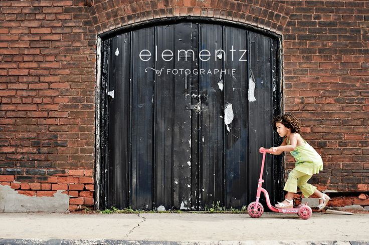 A little girl and her scooter. Photograph by Elementz of Fotographie, shot at 270 Sherman