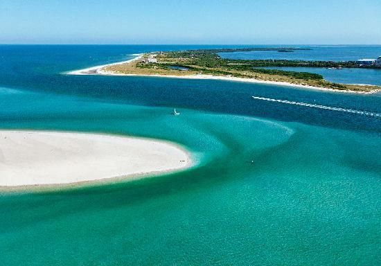 Serene, Caladesi Island State Park, FL was voted America's Best Beach in 2008 by Dr. Beach. Cleanest and most natural-state beach in the Tampa Bay area!     I caught my first pompano here!, right off the tip of the channel.