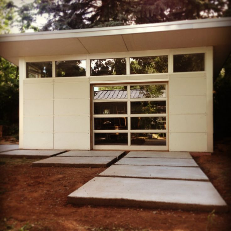www.studio-shed.com From our Designer Series, a custom designed Studio Shed Garage & man cave complete with glass overhead garage door. #studio #shed #man #cave #garage #storage #hobby #art #gym #backyard #green #home #office #prefab #modular