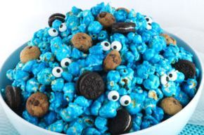 Yummy and adorable Cookie Monster Popcorn - sweet and salty popcorn mixed with mini cookies and googly monster eyes. It is both fun and delicious, a great combination! A fun anytime snack that would also be a great Party food at a Cookie Monster Birthday Party or a Sesame Street Birthday Party. Pin this easy to make dessert for later and follow us for more great Popcorn Recipe Ideas.