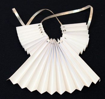 accordian folded paper angel ornament step 9 thread ribbon through holes - Angel Decorations