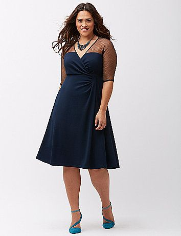 Sugar and Spice dress by Kiyonna edges up the classic A-line fit with sheer fishnet shoulders. The faux wrap fit shows off your shape to perfection, with a surplice neckline and gathered waist detail. 3/4 sleeves. lanebryant.com