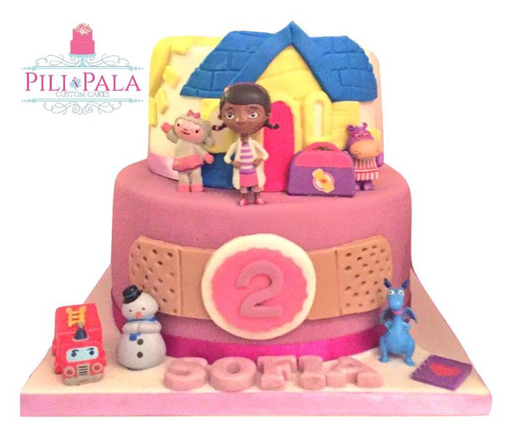 Doc McStuffins themed 2nd birthday cake. 2 tier cake with character figures