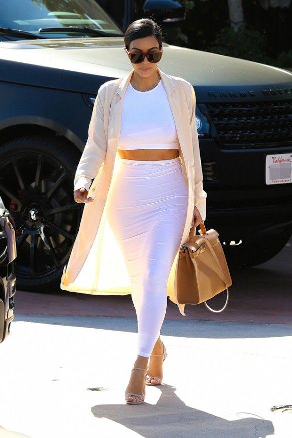 Kim Kardashian in Maison Martin Margiela coat, Wolford dress, Hermés bag, and Prada heels.