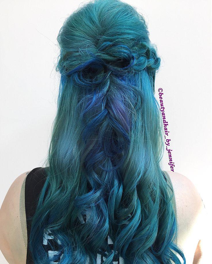 Mermaid fun Braids and waves half up hairstyle.