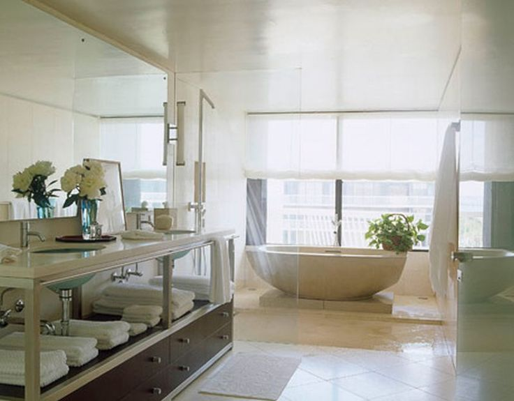 a modern master bathroom in a palm beach condos master bath designer vicente wolf placed clodagh collections zen cast concrete tub on a concrete slab - Modern Master Suite Bathroom