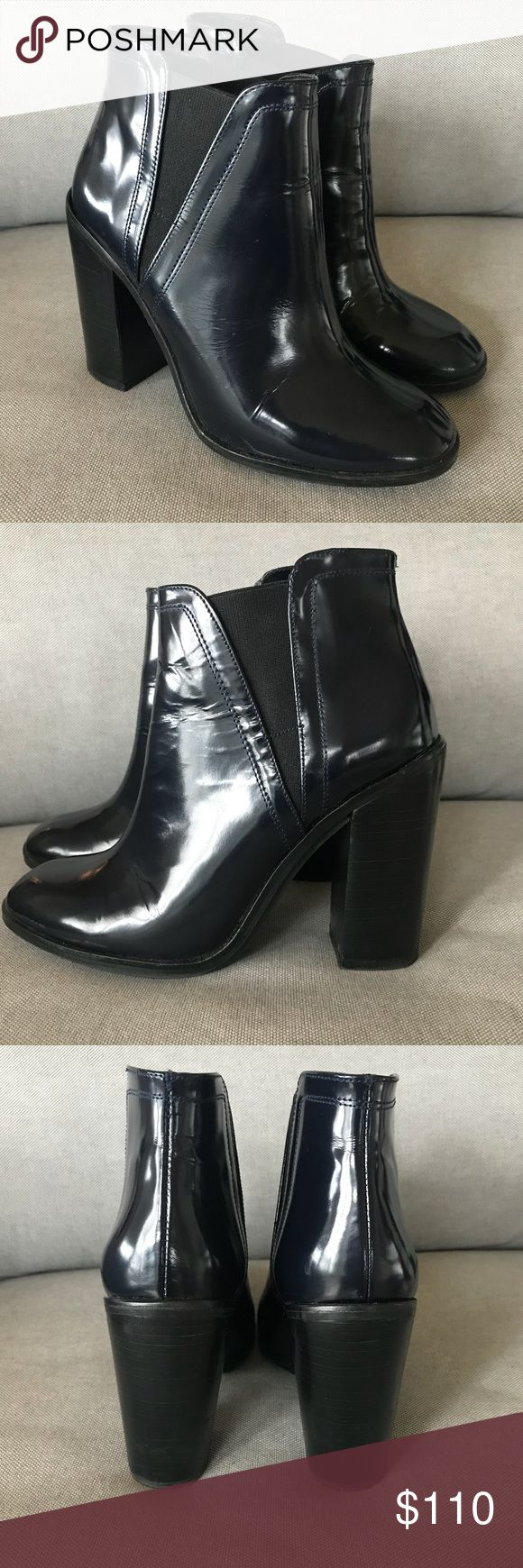 Leather Ankle Boots with Block Heel in Navy Patent leather ankle boots in almost brand new condition. The heels are about 4 inches and the elastic slits on the sides for easy slip ons. They're in a dark navy color, easy to walk in and perfect for the fall and winter seasons. Zara Shoes Ankle Boots & Booties