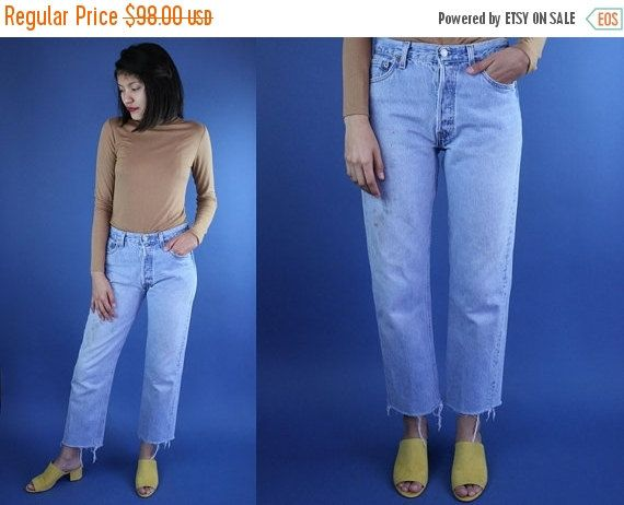 ON SALE Levis 501 Size 27 Medium Wash Jeans Levi's Jeans 27 Button Fly Jeans Size 26 27 Waist Tapered Leg Distressed Levi Jeans Cropped C by DiveVintage from Passport Vintage. Find it now at http://ift.tt/2i2KGAS!