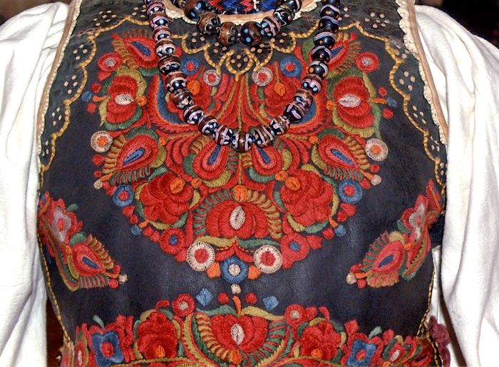 Traditional Hungarian jewelry and embroidery brightly adorn this leather vest from Transylvania (Romania).