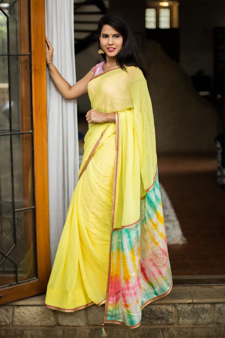 Yellow georgette saree with stone work and rich Banaras brocade pallu #houseofblouse #saree #blouse #shibori #yellow