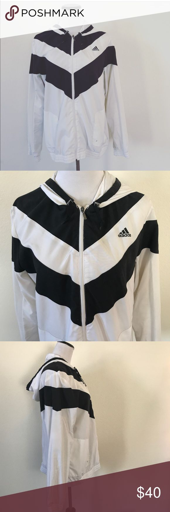 ADIDAS RETRO WINDBREAKER, BLK\WHT CHEVRON PRINT Cool retro Adidas windbreaker, black and white chevron, size XL.  Fits like a women's large and XL. I'm a medium and can wear it, just a little wide.  A couple of little spots on sleeve, see last pic.  Please let me know if you have any questions! adidas Jackets & Coats