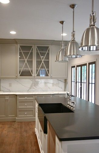 cabinets painted in Benjamin Moore Gettysburg Gray. This might work!