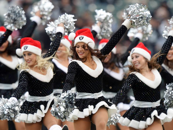 Oakland Raiders cheerleaders perform in Christmas costumes during the game against the Kansas City Chiefs at the O.co Coliseum. (Kirby Lee/US Presswire)