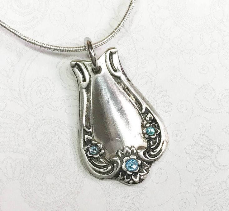 This spoon necklace was crafted from a vintage silverplate tablespoon in the charming Daybreak pattern from 1952. The spoon has been cut, formed, cleaned, polished and treated with a special anti-tarnish cream and look how it shines! It measures 1 1/8, so it's a nice medium size spoon pendant.