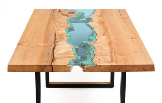 Amazing tables made of wood with blue glass inserts to mimic rivers. Click through to see more of the artist's work and available pieces.