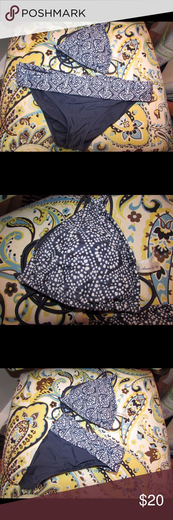 American Eagle Triangle bikini Hardly worn, blue and white American Eagle triangle bikini. Bottoms have a cute waistband matching the pattern on the top. Pads for top are still intact and inside each side of the top. No wear and tear. Like new! I accept reasonable offers 💕 American Eagle Outfitters Swim Bikinis
