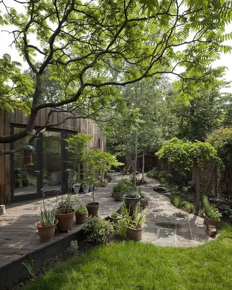 Tree House by 6a Architects -- London studio 6a Architects has extended the home of architecture critic Rowan Moore and his family by adding a timber structure that curves around a tree. The exterior of the structure is clad with reclaimed timber.
