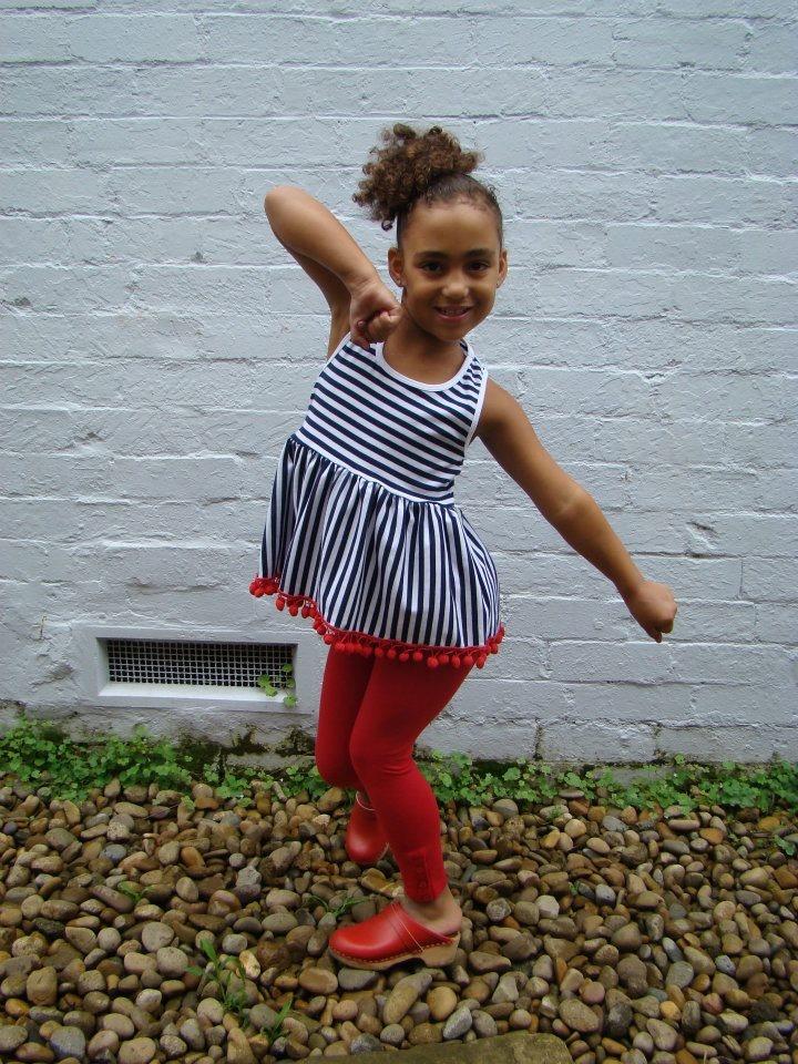 Tik e ta kids Summer Collection 2011: Sabine top  T-bar singlet top with pom pom hem  Navy/white yarn dyed cotton Sizes 2-8.