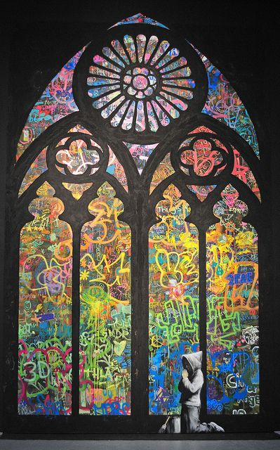 banksy's stained glass window grafitti.   We could get a poster of this.  Very cool!