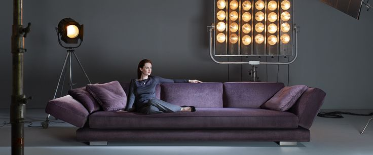 """I.AM.DONE.  This is the most marvelous piece of furniture I've come across.  Enormous """"Luxury-Carousel Purple Leather Sofa"""" makes the model look like a little kid!  I'm so in love with this sofa I can't think straight."""
