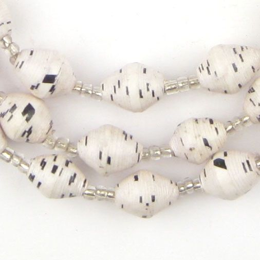 Beautiful strand of speckled white recycled paper beads. These beads are made using recycled newspapers by working mothers in Uganda. Each bead is fair trade and handmade with love. Individual beads m