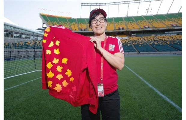 In advance of the FIFA Women's World Cup Canada 2015, kicking off on the 6th of June, Rita Sarrate picked up her uniform along with many of the other 365-plus Edmonton volunteers at the Commonwealth Community Rec Centre on Thursday, May 28, 2015. (Greg Southam/Edmonton Journal)