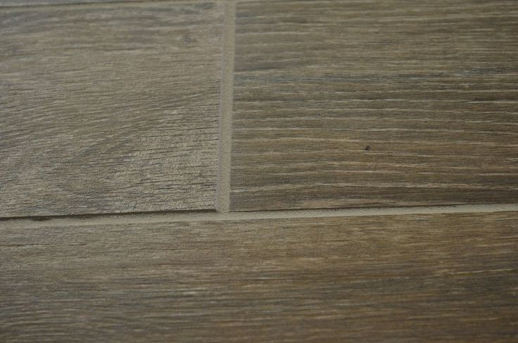 """Wood-plank tile for the kitchen, bathroom or entry. The tile is called """"natural timber cinammon"""" at Lowes. The grout color, Power Grout RTU Light Buff, gives it a nice warm look. Love it!"""