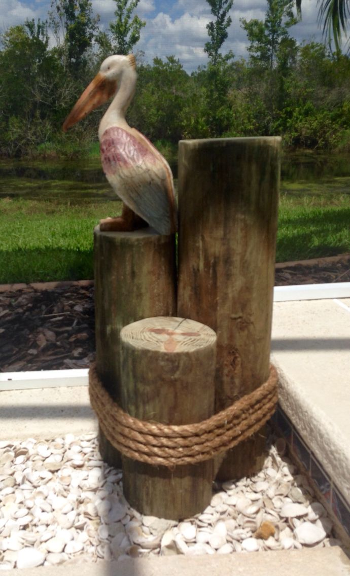 """Nautical wood pilings. Make this for less than $20. 7"""" round treated fence post wrapped with rope."""