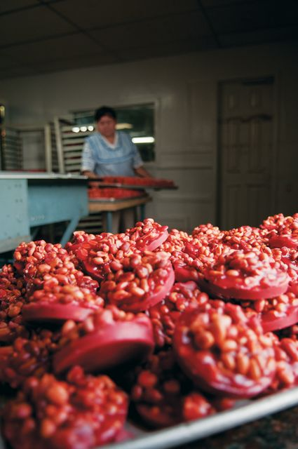 The Tyler Candy Company makes its signature pink peanut patties using the same equipment that founder Anthony George invented in 1941. (Photo by Kevin Stillman)