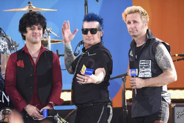 Musicians Billie Joe Armstrong, Tre Cool and Mike Dint of the band Green Day seen on stage on ABC's 'Good Morning America' at Rumsey Field in Central Park on May 19, 2017 in New York City.
