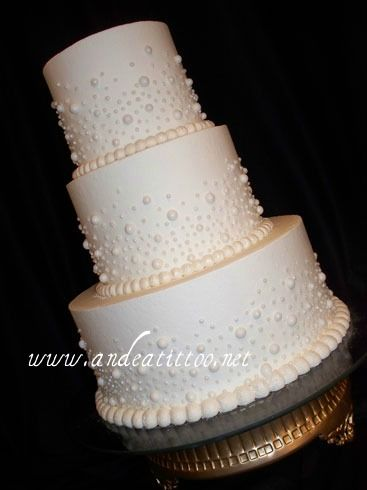 "Love the ""pearl"" affect.  Pearled 2! 12"" & 6"" chocolate rush cake, 8"" white cake, all filled with lemon. Limoncello butter cream over all. The pearls are candy, applied one at a time. Served 92. Reception was held at The Courtyard Mariott in Canton. www.andeatittoo.net"