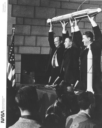 Dr. William H. Pickering, Dr. James A. Van Allen and Dr. Wernher von Braun (left to right) hoist a model of Explorer I and the final stage after the launching Jan. 31, 1958. Explorer I, the first U.S. earth satellite was launched by a Jupiter-C with U.S. earth - IGY scientific experiments of Dr. James A. Van Allen, which discovered the radiation belt around the Earth.