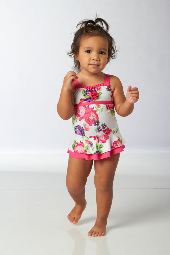 Ruffled Girls Swimwear With a sea of swimsuit options, she can choose from ruffled rash guards, baby bikinis, tankinis and one-pieces too. All of our girls' swimwear is made with UPF 50+ sun protection, and don't forget about the sun hat to match!