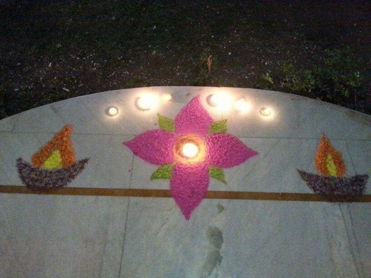 Rangoli and lighted Diya