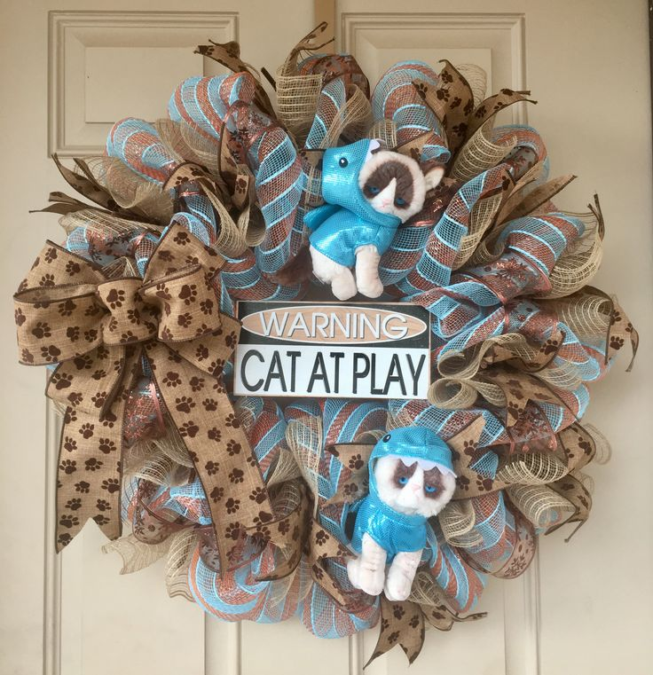 Grumpy Cat wearing Shark Costumes with 2 adorable cats and paw ribbons. Only 1 in stock! Purchase here: https://www.etsy.com/listing/544402571/grumpy-cat-wreath-with-2-adorable-plush ......and here's the famous video of the cat! https://youtu.be/tLt5rBfNucc