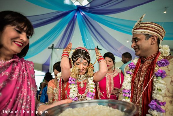 Indian bride throwing rice to guests at wedding ceremony at Moon Palace Cancun #destinationwedding