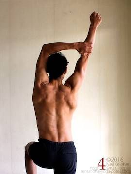 Arm overhead shoulder stretch, pulling one arm to the side, neil keleher, sensational yoga poses.