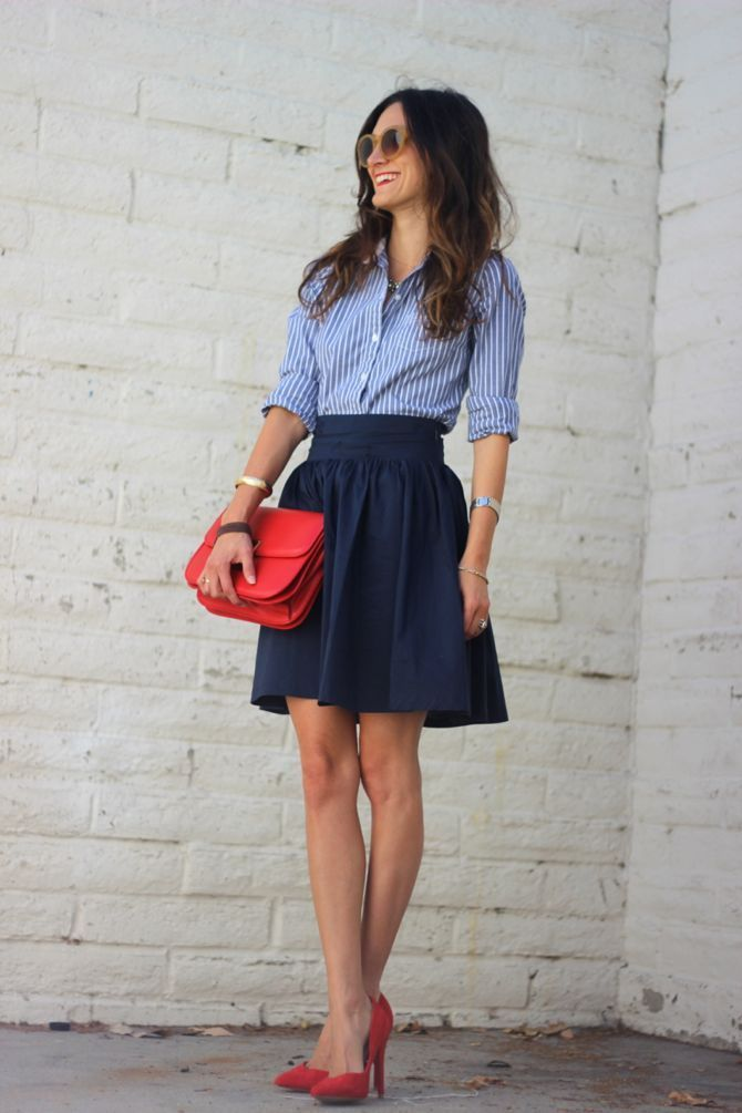Shop this look on Lookastic: https://lookastic.com/women/looks/dress-shirt-skater-skirt-pumps-clutch-sunglasses-watch/10231 — Brown Sunglasses — White and Blue Vertical Striped Dress Shirt — Navy Skater Skirt — Gold Watch — Red Leather Clutch — Red Suede Pumps