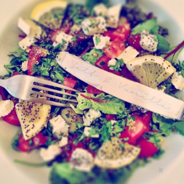 Home made salad: tomato, red onion, slices of lemon, camembert, cucumber, green garlic olives, parsley, a bit olive oil & himalaya salt,  finish it with chia seeds. Goes well with chicken, rise and a yoghurt dip…Have a nice meal!
