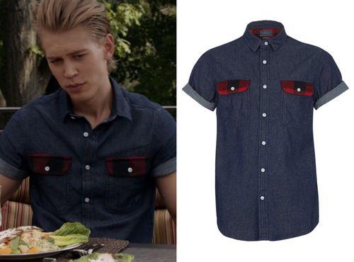 Sebastian wears a dark denim shirt with plaid trimmed pockets