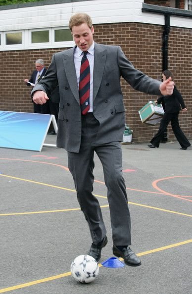 Prince William Prince William tries his football skills during a visit to St Aidans Primary School on May 9, 2008 in Blackburn, England.