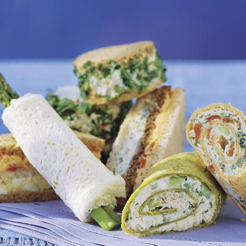 """""""Favorite Finger Sandwiches for a Luncheon,"""" from Southern Living -- """"Tiny finger sandwiches are big on flavor, and always add a festive touch to luncheons. Most sandwiches can be prepared up to a day ahead, and refrigerated in an airtight container."""" Click through for links to 21 different finger sandwich recipes. Shown: Asparagus Rollups, Creamy Vegetable Sandwiches, Curried Chicken Tea Sandwiches"""