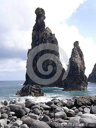 Volcanic cliffs in the Atlantic ocean at Ribeira da Janela in Madeira. Portugal