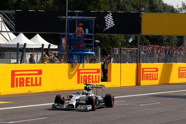 Lewis Hamilton (GBR) Mercedes AMG F1 W05 crosses the finish line to win the Italian Grand Prix. Formula One World Championship, Rd13, Italian Grand Prix, Monza, Italy, Race Day, Sunday, 7 September 2014