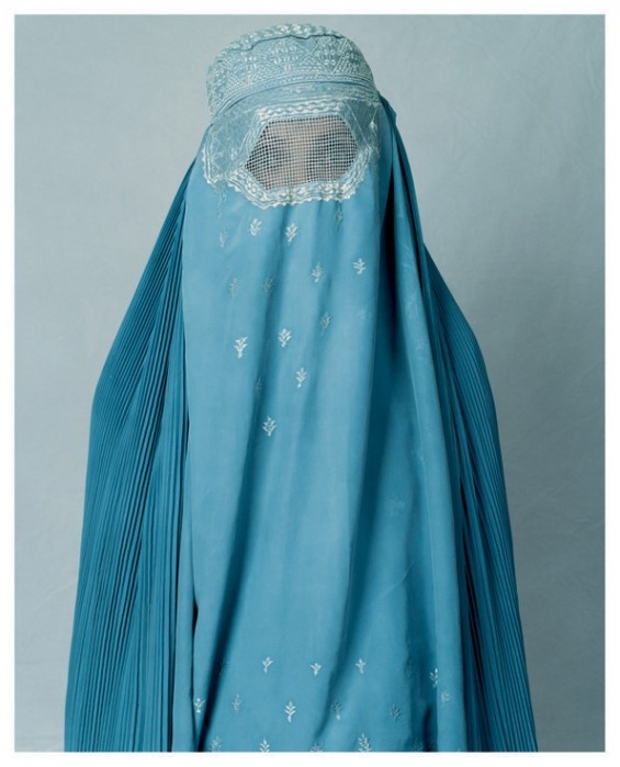 """James Mollison """"Under the Taliban The Ministry of Vice and Virtue enforced bans on music, dancing, television, radio, kite flying and wearing white socks—and women were forced to wear a burka."""" - Basima, 16, Pol-i-Charki, Afghanistan"""