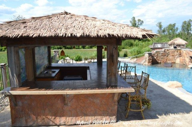 Outdoor tiki hut pool house and outdoor kitchen bar area for Outdoor pool bar ideas