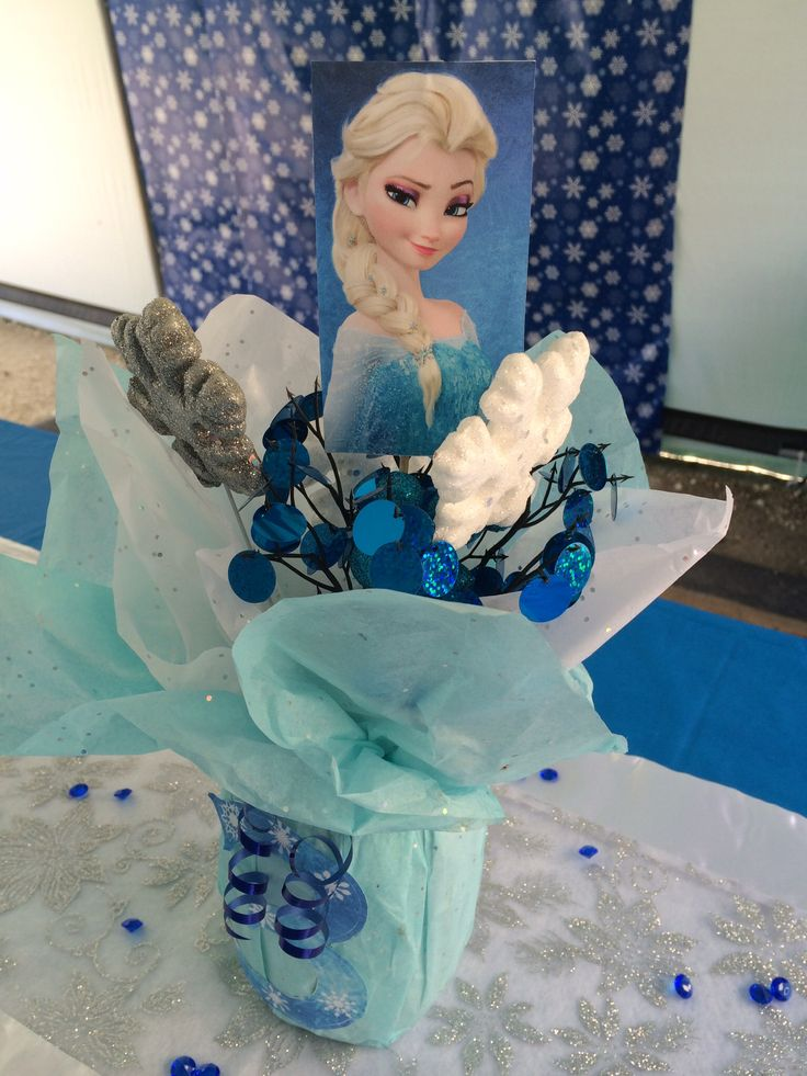 Frozen themed birthday party for my goddaughter. Elsa/snowflake centerpiece. DIY. With tissue paper, mason jars, and snowflake sticks from the dollar store.