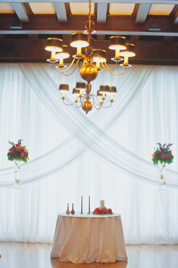 Beautiful Winnipeg ceremony draping by Planned Perfectly Venue @Manitobaclubweddings #wedding #twogrooms #weddinginspiration #ceremony #Itsallinthedetails #groom #Inspiredeleganceevents #autumnwedding #fallwedding