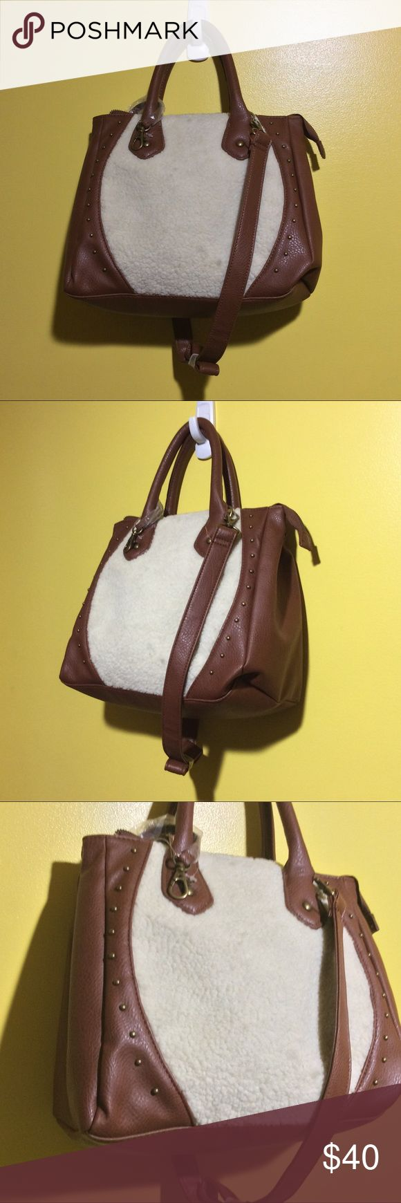 Brown/Cream Wool and Leather Carlos Santana bags Brand New With Tags brown and cream with copper studs Carlos Santana Handbag. This handbag is wool and leather and it comes with a wool coin purse. Leather wrapped handles and a leather shoulder strap. Zipper closer and side clips Carlos Santana Bags Shoulder Bags